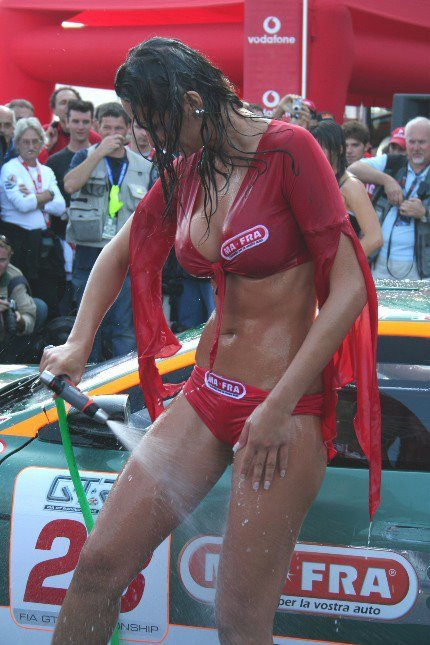 italian woman in red washing the car