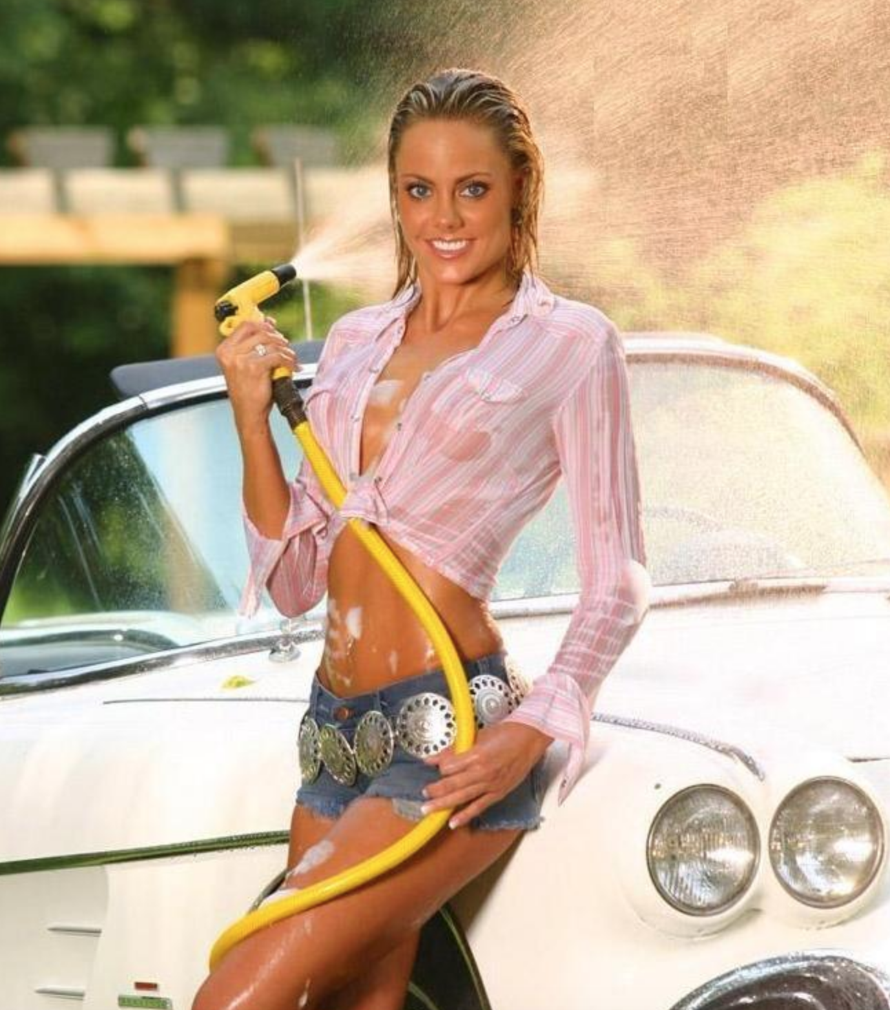 jean skirt washing white car with yellow hose