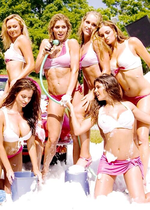 group of sexy women washing a car