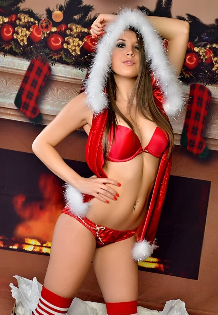 sexy brunette girl by holiday fire