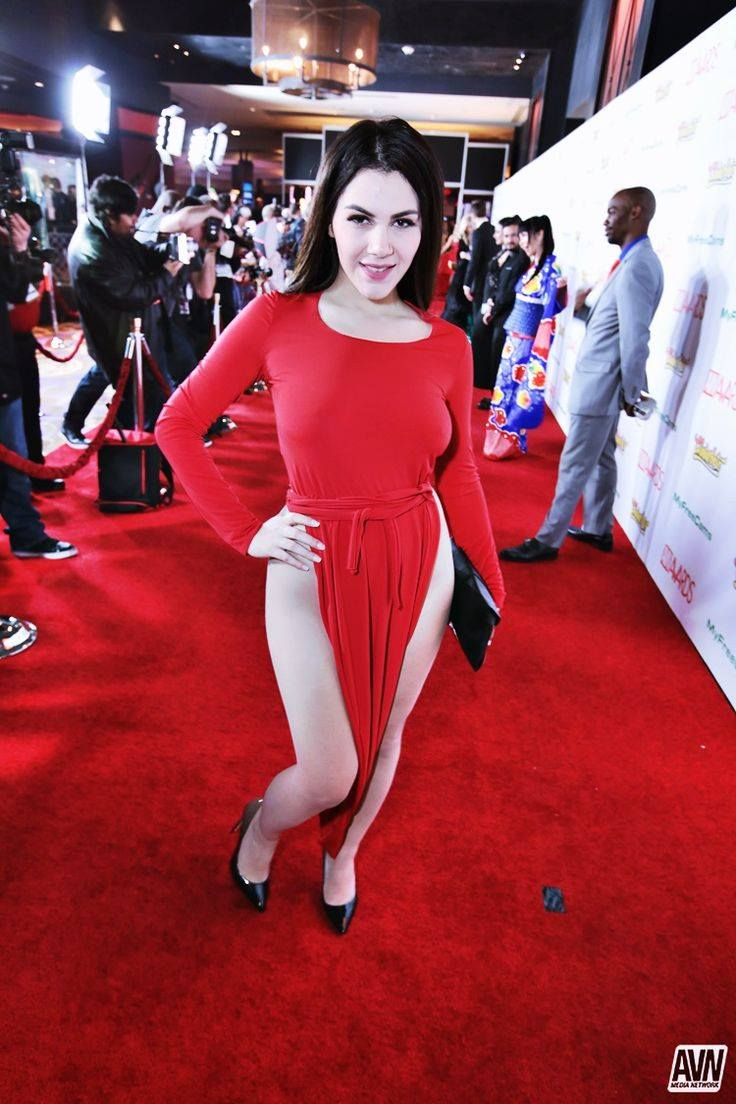 brunette babe hot red dress revealing red carpet avn