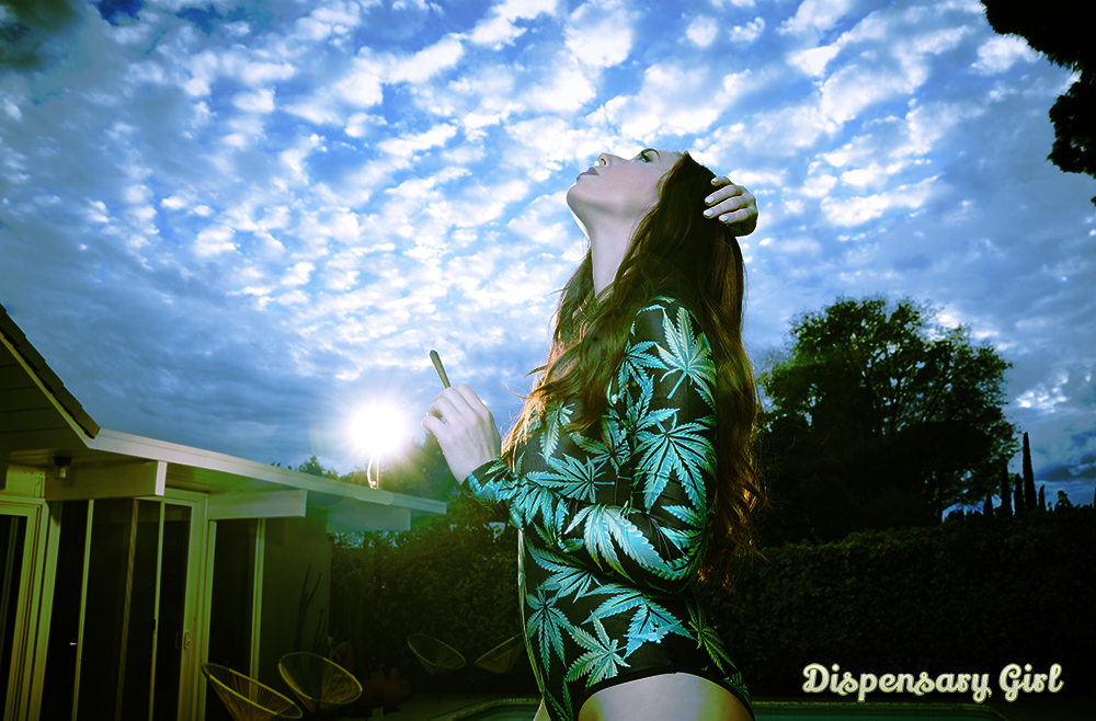 Beautiful girl smoking weed in the clouds