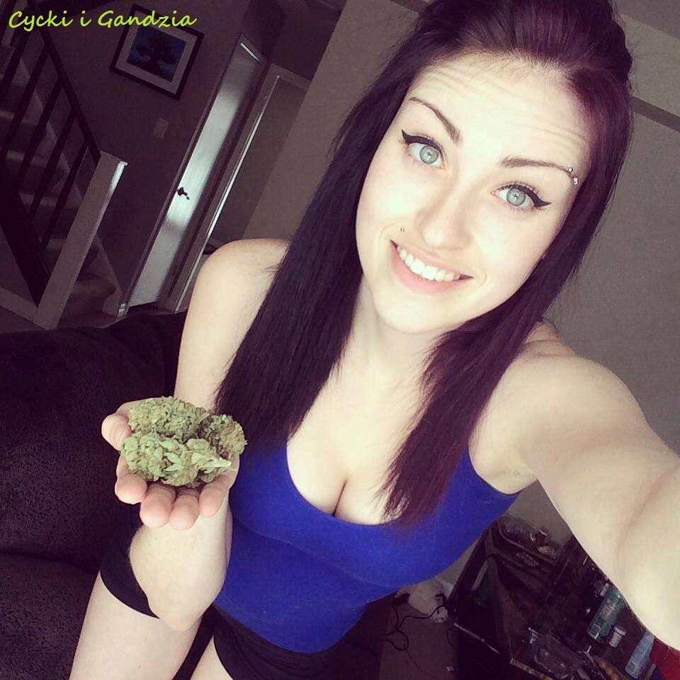 brunette girl with hand of buds