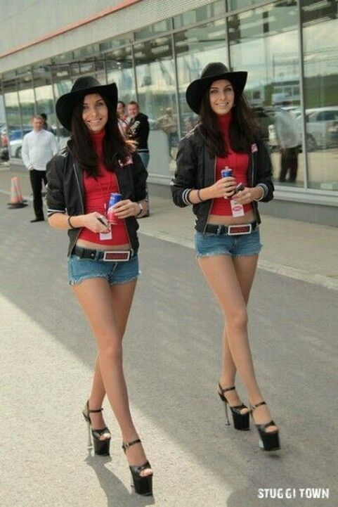 dressed up brunette twin sister babes at airport