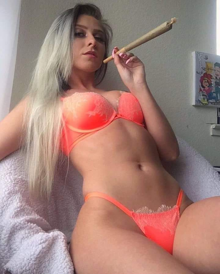 blonde hottie in orange bikini with monster blunt joint high weed
