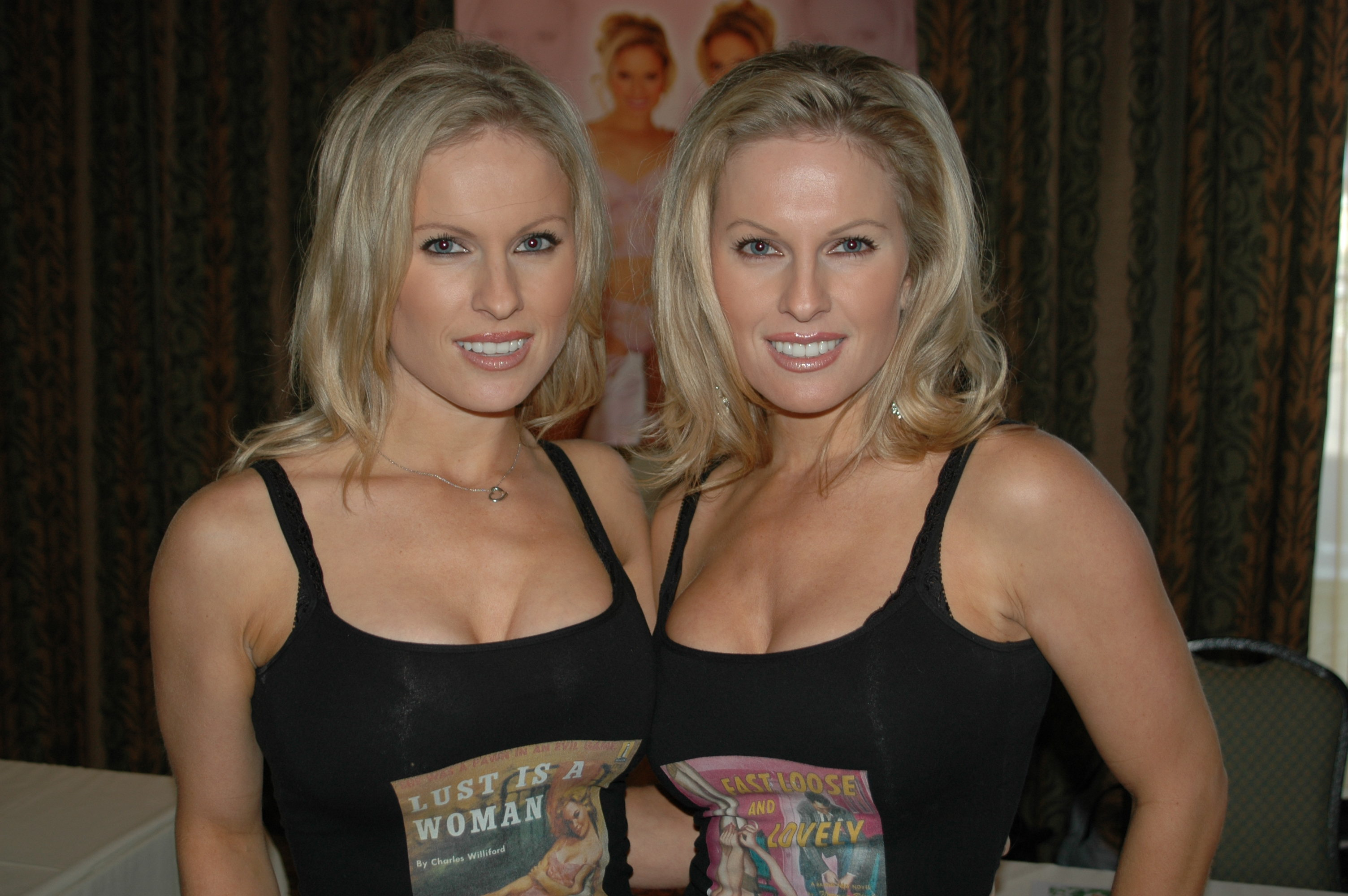 sexy blonde haired twin sisters in black tank tops