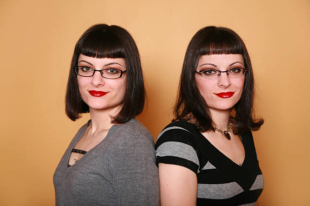 rockabilly babe twin sisters with glasses and bangs