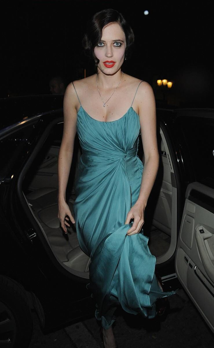 sexy eva green star of dumbo in green dress in hollywood