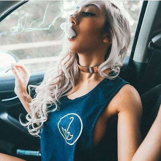 blonde babe taking big joint hit in car