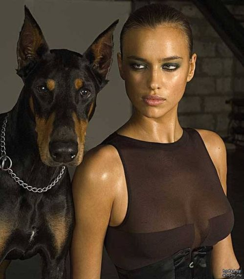 brunette model close up with doberman