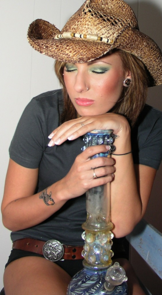 sweet girl in cowboy hat in love with her bong