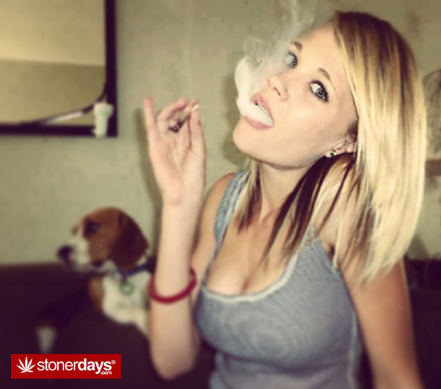 blonde babe taking the big drag with dog in background