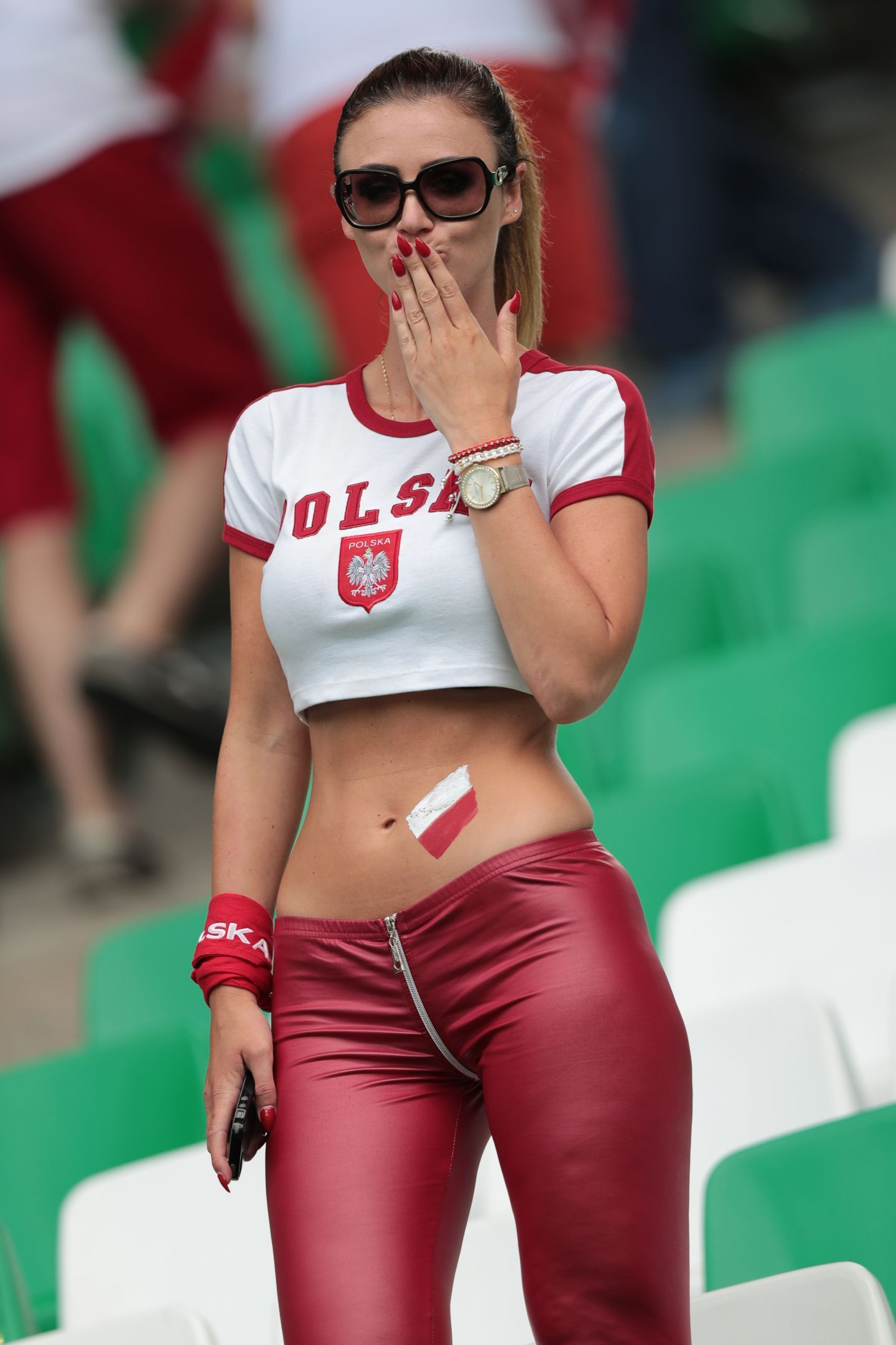 futbol fan pretty in red velvet pants tight