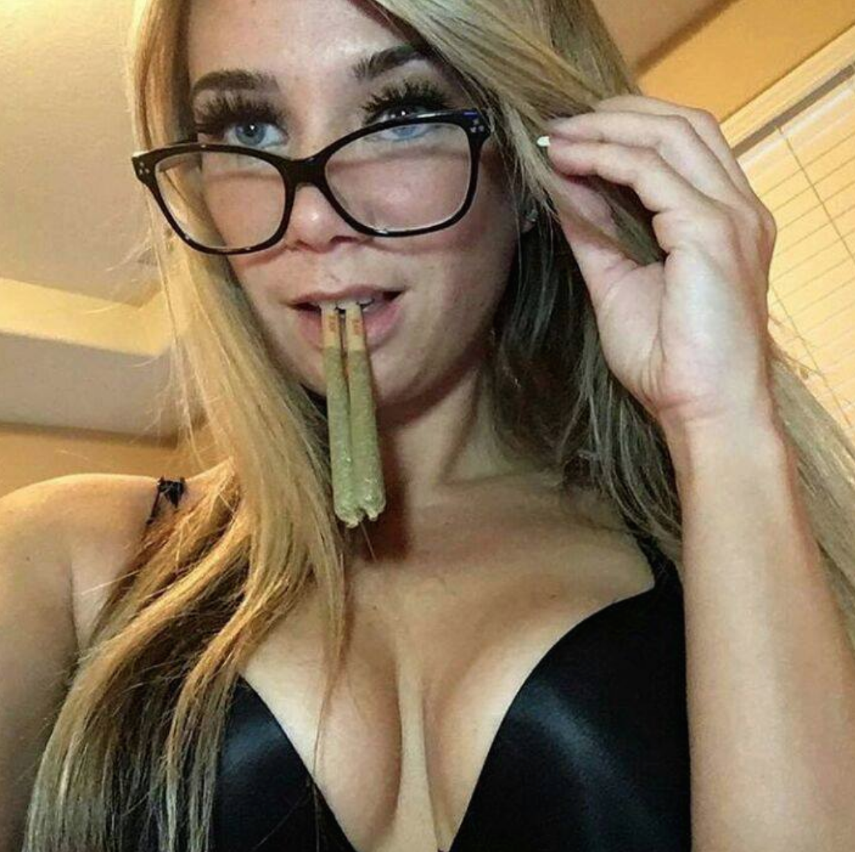 knockout blonde in glasses and black bra top