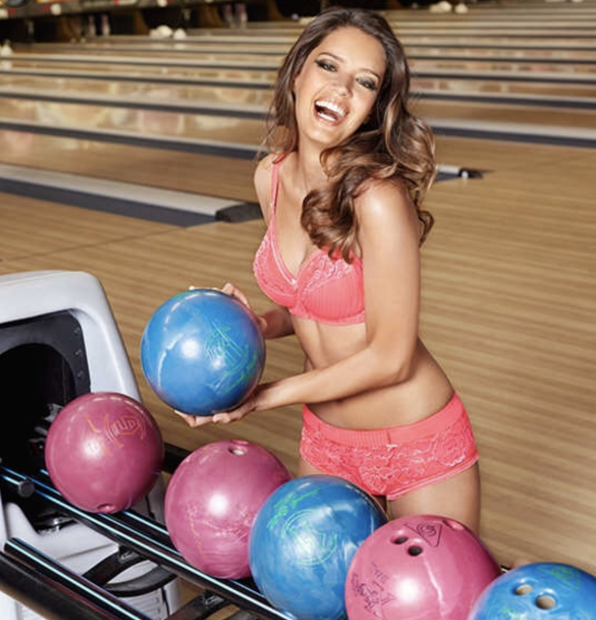 bowling babe in lingerie with blue ball