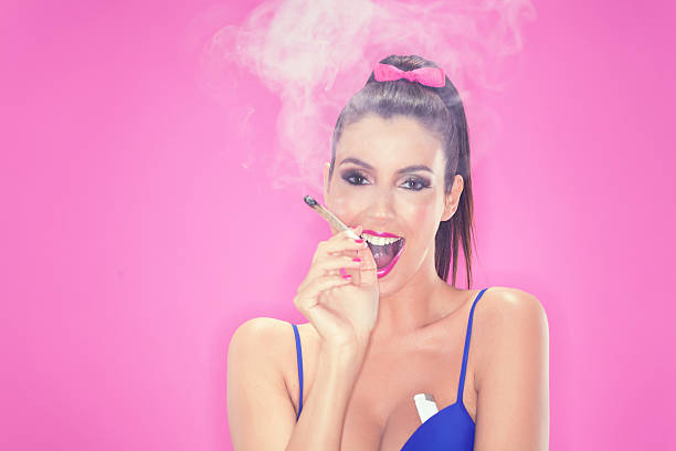 brunette model with joint pink background
