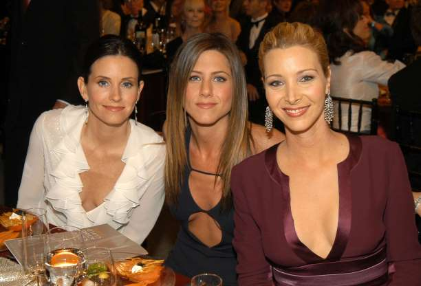 the cast of friends at a nice dinner